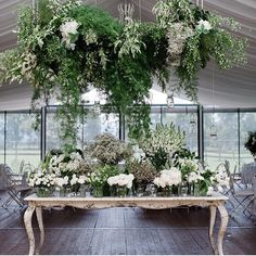 Green and white florals, reception and overhang decor foliage clean simple