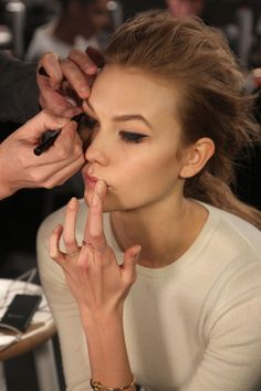 Karlie Kloss helps put on some #backstage touches