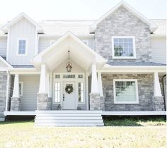 Love the white front door and Exterior grey stone. The exterior stone is gray w… Love the white front door and Exterior grey stone. Design Exterior, Grey Exterior, Modern Farmhouse Exterior, Wall Exterior, Farmhouse Style, Rustic Farmhouse, Farmhouse Remodel, Exterior Siding, Craftsman Exterior