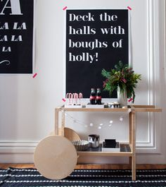 Our party snack and bar cart! We used Staples' in-house copy center to print oversized posters with holiday phrases on them—perfect for photo booth backgrounds or just some extra flair. Download the set here!