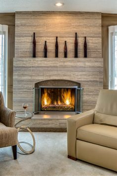 This living room and fireplace redesign just won us our 8th consecutive ASID award! From Our Blog at Design Connection, Inc. | Kansas City Interior Design http://www.designconnectioninc.com/blog #InteriorDesign