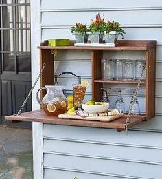A salvaged kitchen cabinet, on its side with support chains added... The door becomes a shelf. Simple to add a latch to keep it closed.