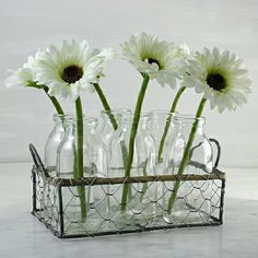 Vintage style flower holder with six mini glass milk bottles perfect present  for the summer season great for stems or buds supplied with faux gerbera for the days you don't have fresh blooms