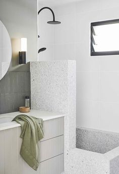 Bathroom: The combined shower/bath lined in 'Dove Grey' terrazzo tiles from Fibonacci Stone is inspired by Roman tubs. Bathroom: The combined shower/bath lined in 'Dove Grey' terrazzo tiles from Fibonacci Stone is inspired by Roman tubs.