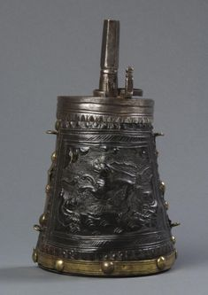 Powder Flask, Italian, ca. 1580, Embossed, hardened, and cut leather (known as cuir-bouilli), gilded brass, iron Dimensions: 8 1/4 x 4 3/4 inches, 0.8 lb. (21 x 12.1 cm, 0.36 kg) Philadelphia Museum of Art, Accession Number: 1977-167-890