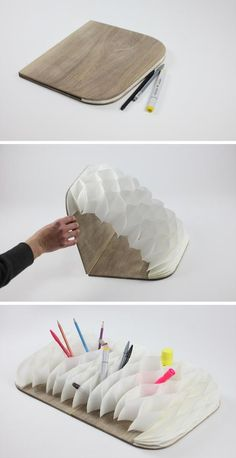 'Paper Storage' / PINWU Studio. Book which folds out and has a concertina honeycomb insert which you can use as a pencil holder. Stationary love