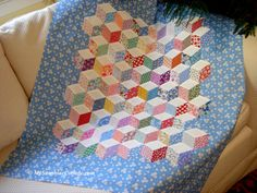 Tumbling Blocks baby quilt top. English paper pieced and appliqued to 4 wide border strips.