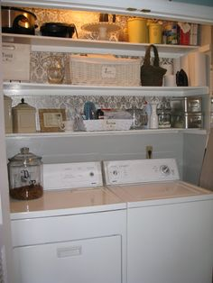 Laundry room idea - wallpaper made out of wrapping paper and spray adhesive (brilliant), shelves, pretty containers