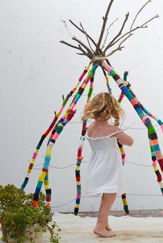 dancing under the yarn bomb tee pee  