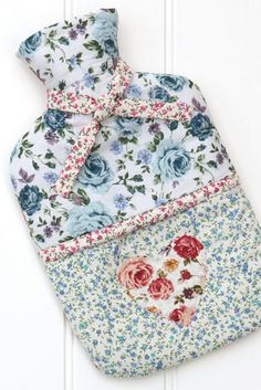 Stay warm during the colder months by sewing a pretty cover for your hot-water bottle