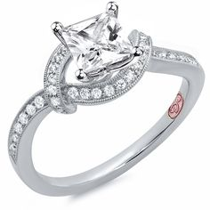 Designer Engagement Rings from DemarcoJewelry.com  Available in White Gold 18KT and Platinum.0.26 RD  Capture her grace and endless beauty with this confident yet elegant design.  We have also incorporated a unique pink diamond with every single one of  our rings, symbolizing that hidden, unspoken emotion and feeling one  carries in their heart about their significant other.    This is not just another ring, this is a heirloom piece of jewelry.