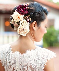 A Spanish Rose Wedding HairstyleThis gorgeous bridal updo is more muted in color, but no less beautiful. Plus, a hairstyle like this won't interfere with wearing a Mantilla veil -- typical in traditional Mexican Catholic weddings.