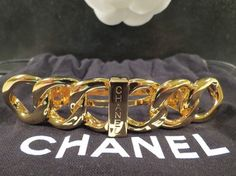 NWOT WOMENS AUTHENTIC CHANEL GOLD LOGO HAIR BARRETTE $430