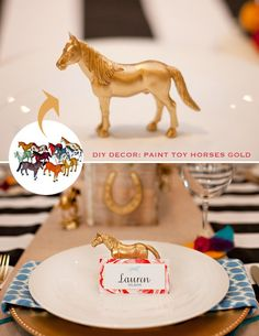 toy horses painted gold used as place cards