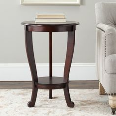 This dark cherry pedestal side table will make a beautiful accent piece in any room. Crafted of sturdy pinewood, the design of this table offers plenty of functional use while retaining a modern style that will complement your decor.