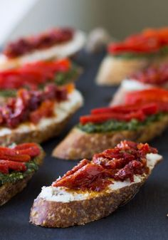 Food For Thought | Sun-Dried Tomato and Goat Cheese Crostini -- Sophisticated and decadent finger food to please your party guests!