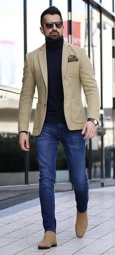 @makanveli - with a business casual outfit featuring a black turtleneck tan blazer silk pocket square brown leather banded watch slim blue jeans suede zipper boots  #fallfashion #falloutfits #menswear #menstyle #mensapparel #blazer #businesscasual #mensfashion #turtleneck #sweater #boots