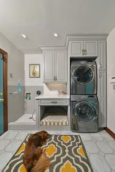 Dream Laundry Room with stackable washer dryer, pet bath/pet shower, and custom pet bed...included in the Postbox Designs Pet Decor Round Up [Design: Artistic Renovations of Ohio]
