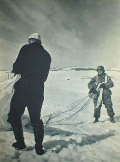 A fallschirmjäger is helped by a sailor from the Kriegsmarine after a jump over Bjørnfjell, Norway, during the battle of Narvik April Notice the helmet. Obviously he has jumped with without sustaining neck damage. Narvik, Paratrooper, Luftwaffe, The Third Reich, World War Ii, Wwii, Norway, Sailor, Battle