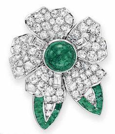 AN EMERALD AND DIAMOND BROOCH, BY VAN CLEEF & ARPELS   Designed as a circular and single-cut diamond flower blossom, with a cabochon emerald pistil and baguette-cut diamond stamen, extending two calibré-cut emerald and single-cut diamond leaves, mounted in platinum  Signed V.C.A. for Van Cleef & Arpels, N.Y., no. 51552