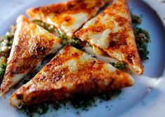 Italian Potato Cakes- triangles of crisp-edged Yukon Gold potatoes enhanced with onions and cheese, finished with cilantro vinaigrette