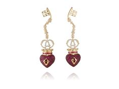 """The """"Key of a Heart"""" earrings, made in yellow gold with rubies and diamonds."""