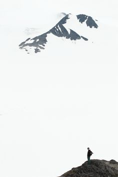 Distant peaks emerge from the clouds over the Harding Icefield, in Alaska's Kenai Fjords National Park.
