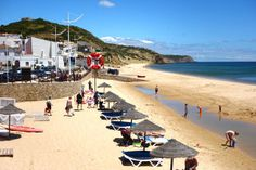 Salema, the Back Door jewel of the Algarve, comes with a delightful sandy beach overlooked by characteristic restaurants and the tranquil strum of a steady surf. By Rick Steves - Algarve, Portugal Algarve, Great Places, Places To Go, Cruise Planners, Rick Steves, Jewel Of The Seas, European Tour, Spain And Portugal, Fishing Villages