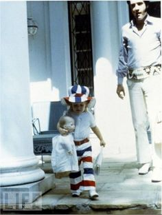 Elvis and Lisa Marie on the front steps of Graceland -