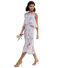 This floral dress will give even the prettiest of gardens a run for the money. (Bonus: the double-tiered effect doesn't just look chic—it's equally flattering on both larger and smaller busts).