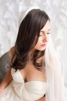 Swiss dot veil on bride with long waves and simple dress