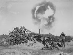 "US 155mm field gun ""Long Tom"" pummels German positions near the Italian town of Nettuno on Feb 13, 1944. Note the awe-inspiring muzzle fireball. Crew members try to protect their ears. The oldest trick was to keep your mouth open too in order to help equalize pressure between the inner and outer surfaces of the ear drum. A well trained crew could fire 20-25 shells per minute."