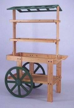 This wood display cart features a classic style that will charm your customers. This wood cart is known for increasing sales of retail products. Produce Displays, Craft Show Displays, Store Displays, Produce Stand, Wood Projects, Woodworking Projects, Woodworking Workshop, Woodworking Bench, Bar Deco