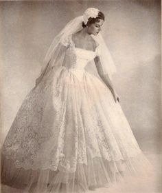 Sigh. I would not have liked to live as a woman in the 50's, but I would loooove to get married in this getup.
