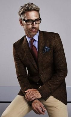 Something as simple as teaming a dark brown wool sportcoat with camel chinos can potentially set you apart from the crowd.   Shop this look on Lookastic: https://lookastic.com/men/looks/blazer-dress-shirt-chinos-tie-pocket-square/13476   — Light Blue Dress Shirt  — Navy Polka Dot Pocket Square  — Burgundy Tie  — Dark Brown Wool Blazer  — Khaki Chinos