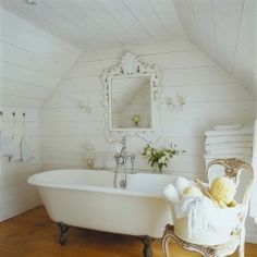 Do you love exposed beams and airy white as much as I do, or is it a little too shabby chic?