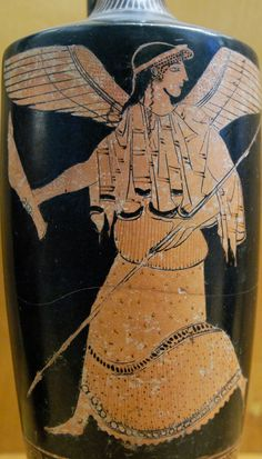 """The goddess Nike, with a spear and a greave. Attic red-figure lekythos, attributed to the Painter of Palermo 4; ca. 470-460 BCE. Found at Gela, Sicily; now in the Regional Archaeological Museum """"Antonio Salinas,"""" Palermo. Photo credit; © Marie-Lan..."""