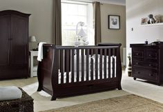 Finished in rich dark cherry, the Dorchester collection from Silver Cross creates an elegant and tasteful nursery. Handcrafted from wood, the furniture set comprises a grand sleigh-style cot bed which transforms into a toddler bed and day bed, a full-size wardrobe and a dresser/changing unit.