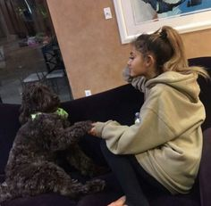 @arianagrande63 ariana + dogs = the cutest thing ever ♡