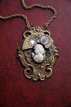 Steampunk Necklace - Victorian Cameo with Steampunk Watch Gears and Antiqued Brass - Steampunk Cameo Necklace. $60,00, via Etsy.