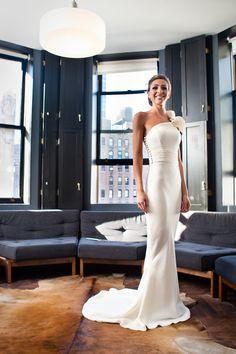 one-shoulder wedding gown.