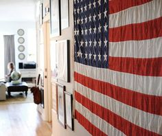 Jen Altman hung a huge old American flag in the long hallway that separates the bedrooms from the rest of her Brooklyn apartment.