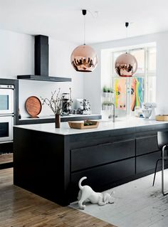 black cabinets, white counter + walls, wood floor,