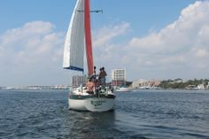 Sail The Emerald Coast In Style:  A scenic sailing trip is one of the most relaxing ways to explore Destin's emerald green waters. Located minutes away from our hotel in Destin Florida, Emerald Coast Sailing offers yacht cruises that leave from Destin Harbor and take guests into the Gulf of Mexico. - Follow the link to read more about sailing in Destin!