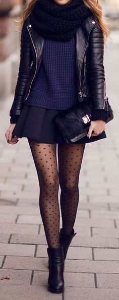 Black skate skirt, navy sweater, black leather jacket, black heart tights, black boots, black boots