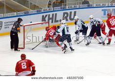 MOSCOW, RUSSIA - SEPTEMBER 27, 2016: M. Plotnikov (88) and A. Ugolnikov (13) fight on a gate on hockey game Spartak vs Ugra on Russia KHL championship on September 27, 2016, in Moscow, Russia http://www.shutterstock.com/pic.mhtml?id=492207100  #arena, #attack, #berdnikov, #competition, #defender, #dribble, #fall, #fight, #game, #gate, #goalkeeper, #helmet, #hockey, #ice, #khl, #kontinental, #league, #luzhniki, #men, #moscow, #offencive, #plotnikov, #referee, #rink, #russia, #spartak, #sport…