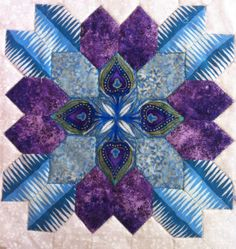 Quietly Quirky Quilter--I love the intricacy of this quilt as well as the colors