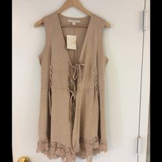 ❤️Host Pick ❤️Pretty Faux Suede Lace Vest❤️ Buttery soft vest with triple-tie front, back embellishment detail and lace trim. Slimming side ties. • Polyester/spandex. • Hand wash. • Sizes XS(2-4), S(6-8), M(10-12), L(14-16) • Taupe. Boston Proper Jackets & Coats Vests