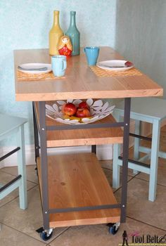 I need this for my little apartment, table and extra counterspace!  Build a stylish DIY multi-functional table.  Free plans for a rolling industrial counter table, rolling island with lots of open storage.