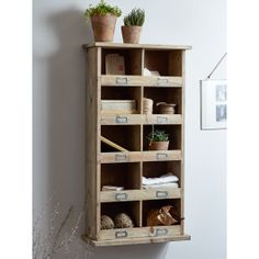 Made from robust, specially selected spruce wood, each Tall Wooden Box Unit features ten handy cubby holes with metal-framed label slots. Ideal storage for your hallway or utility room, our large box unit can be fixed to the wall, sat on a worktop or left freestanding on the floor.